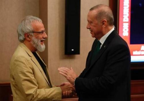 Recep Tayyip Erdogan (R) shakes hands with British singer-songwriter Yusuf Islam, formerly known as Cat Stevens (L), on 31 October 2019